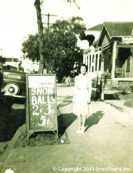 Regina, 13 yrs old at grocery store 1939 Snow Balls sign